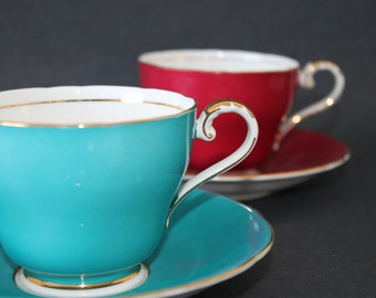 TWO AYNSLEY Bone China Teacup and Saucer Sets.