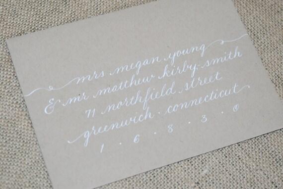 Wedding calligraphy invitation envelope addressing white ink