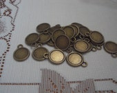 "50 Bronze 1/2"" Round Frame Charms Same Front and Back"
