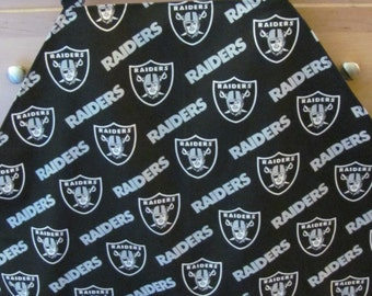 "black and gray ""Raiders"" fabric apron"