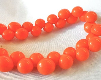Vintage Orange Glass Buttons.