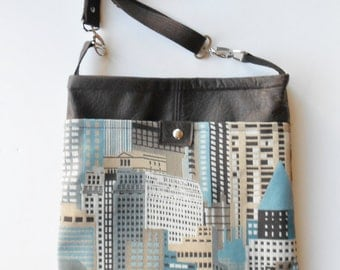 Cityscape, crossbody or shoulder bag to hold your ipad in blues and browns.