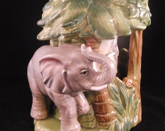 "Vintage  music box of the elephant and palm tree animated by ""Otagiri 1981"""