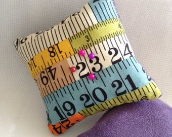 Tape measure pin cushion