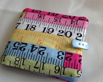 Tape measure needle case