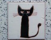 Handmade ceramic tile with a little cat