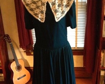 Blue velvet prairie dress with lace Peter Pan collar..