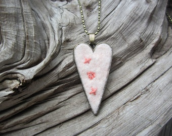 Pale peach felted wool heart with coral embroidered hugs and kisses