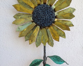 metal sculpture of sunflower