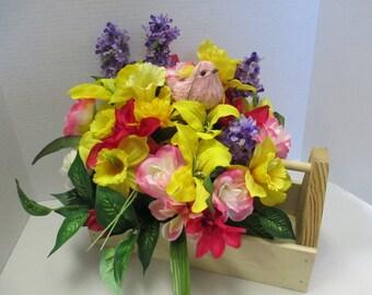 floral arrangement in a wooden utility box .
