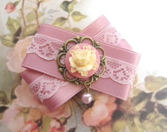 Sugar pink - bow brooch rose from satin band with rose cabochon