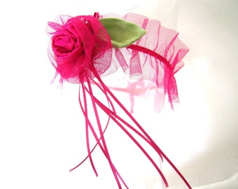 Fashion accessory, Luxury lingerie, garter in tulle fuchsia net and silk flower.