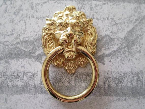 gold drawer pulls. details. lion drawer pull gold pulls