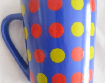 vibrant polka dot ceramic mug primary colours