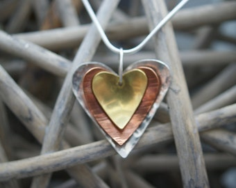 Handmade silver, copper and brass heart-shaped pendant