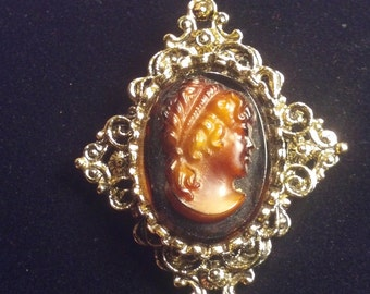 Gerry's Cameo in gold toned setting brooch vintage