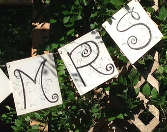 A large  Wedding Banner , made of Mr & Mrs letters, to be strung up .