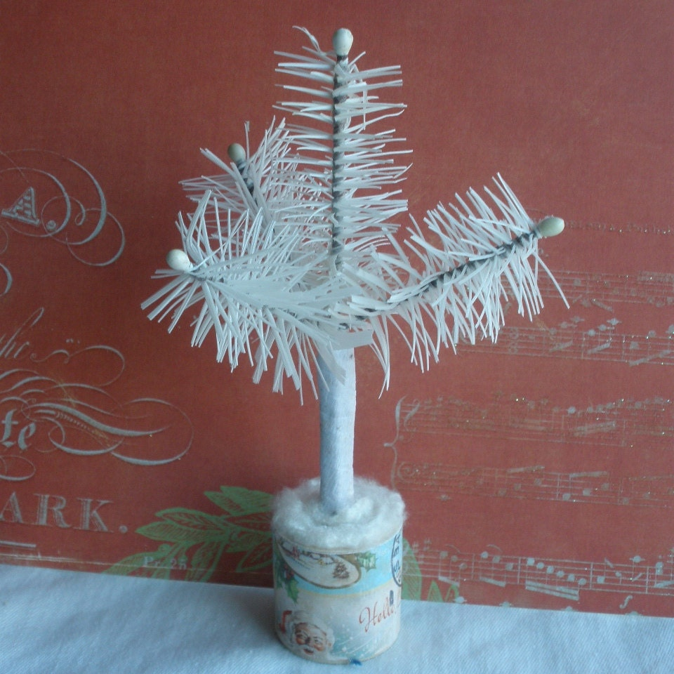 "White three branch feather tree, 6"" inches tall, it comes in a blue spruce color, or a mossy green color. With or without candles."