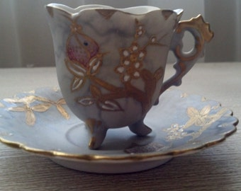 Vintage three footed tea cup hand painted with gold raised design, made in Japan