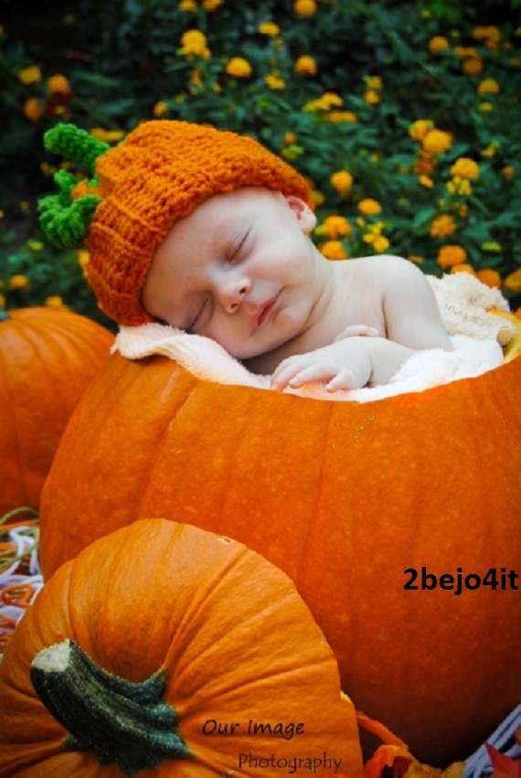 Newborn infant baby boy or girl pumpkin hat or hat and diaper