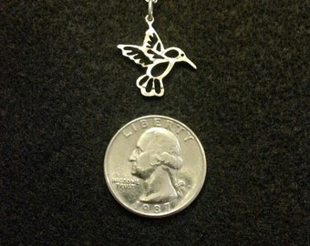 Hummingbird coin jewelry pendant cut from a US quarter