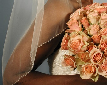 Wedding veil - 34 inches long and 72 inches wide with glass beads edging.