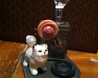 Kitty Couture dada assemblage