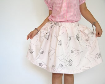 girls skirt, floral print on pale pink, two pockets, 6 year old girl