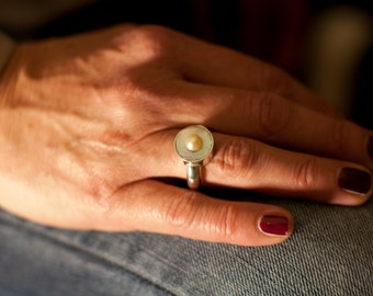 Silver ring with Pearl in the setting and a freshwater pearl.