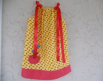 Yellow and red girls pillow case dress in a size 6.
