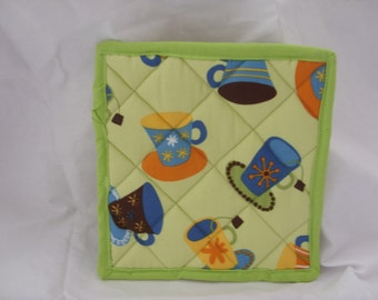 Green fabric pot stand or pot holder with mug design
