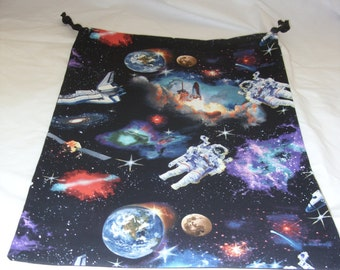Gym bag with spacemen in outer space design