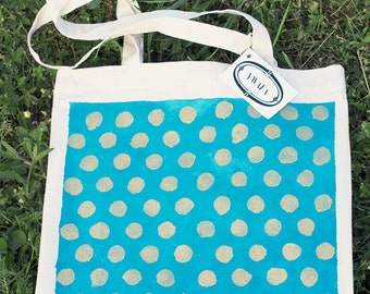 gold dots on blue tote bag