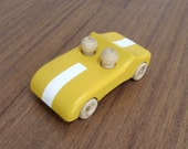 Handcrafted wooden yellow car with white stripe - pretend play car toy with two peg people