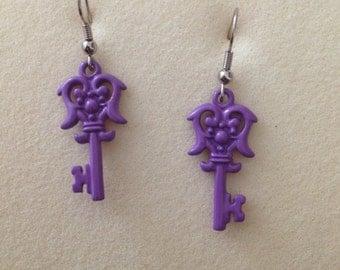 Purple key earrings