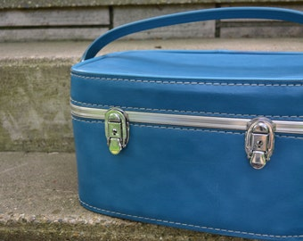 BLUE TRAIN SUITCASE