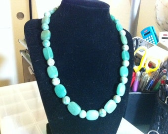 Green gemstone necklace with matching earrings