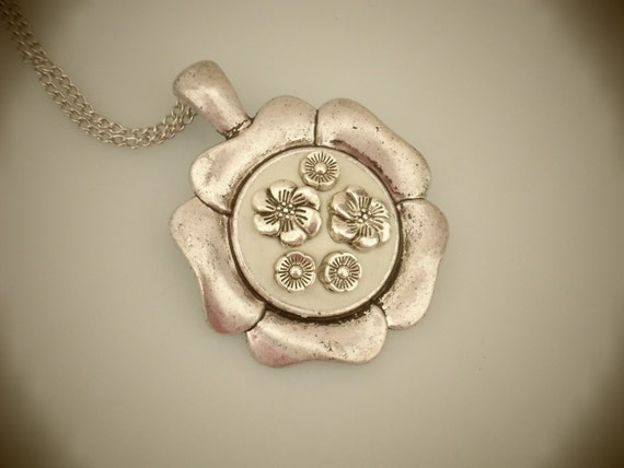 Flower shaped antiqued- silver bezel Pendant using white Epoxy clay and silver flower charms