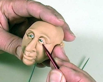 A PFDVD - Sculpt using Puzzle-Face Push Molds by Maureen Carlson.  It's a great tool for polymer clay users.