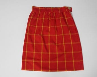 vintage orange and yellow plaid skirt with a wooden button