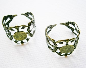 2 Antique Bronze plated brass filigree adjustable rings with glue pad.