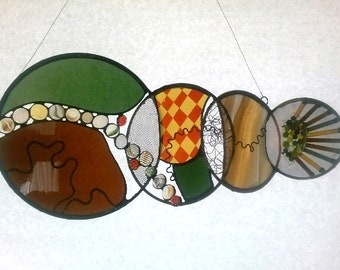 A fabulous Stained Glass Panel, a high quality and unique piece.  Made with a variety of techniques, with a fun and funky design.