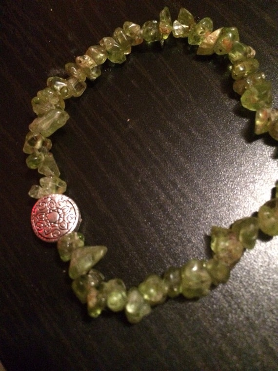 Peridot chipped stone hand beaded bracelet with accent charm