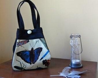 Black fabric handbag .  Small handbag. Folds flat for travel.Blue butterfly pocket. Easy care. Handmade.
