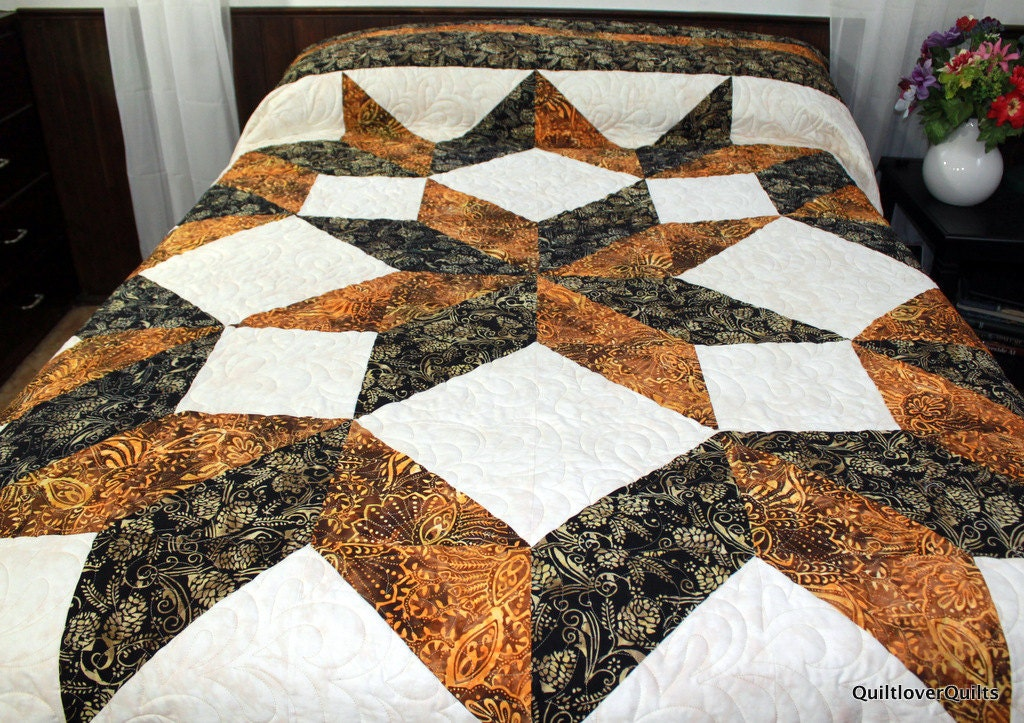 If so, and since that is not a typical quilt size found in patterns, I would suggest using the dimensions found in this blog post and altering a quilt pattern to fit. A simple way to do that is using a pattern that uses the same block as a repeat – eg.