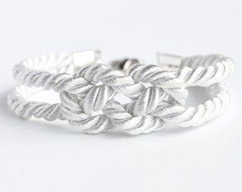 Shiny white double infinity knot nautical rope bracelet with silver anchor charm