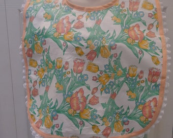 SPECIAL NEEDS BIB: Adult Bib/Make-up/cover-up, vinyl floral print, flannel backing, peach, bias tape trim,with lace