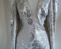 crazy 80s silver BOMBSHELL PAGEANT dress with tear drop asymmetrical bottom and open back, size s