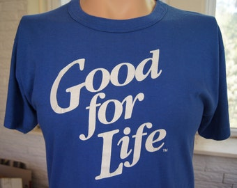 """t shirt (vintage) """"Good For Life"""" Blue 80s Big Print Tee (40 inches around chest)"""
