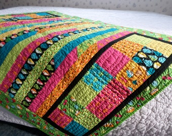 Fresh Picked lap quilt.  Bright and cheery fruits and vegetables pictured on the cotton material